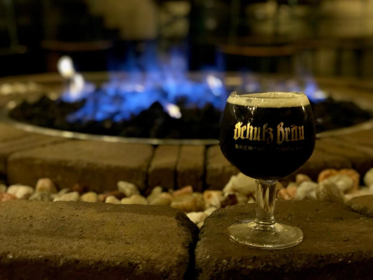 Bourbon barrel-aged Doppelbock by the fire pit at Schulz Brau