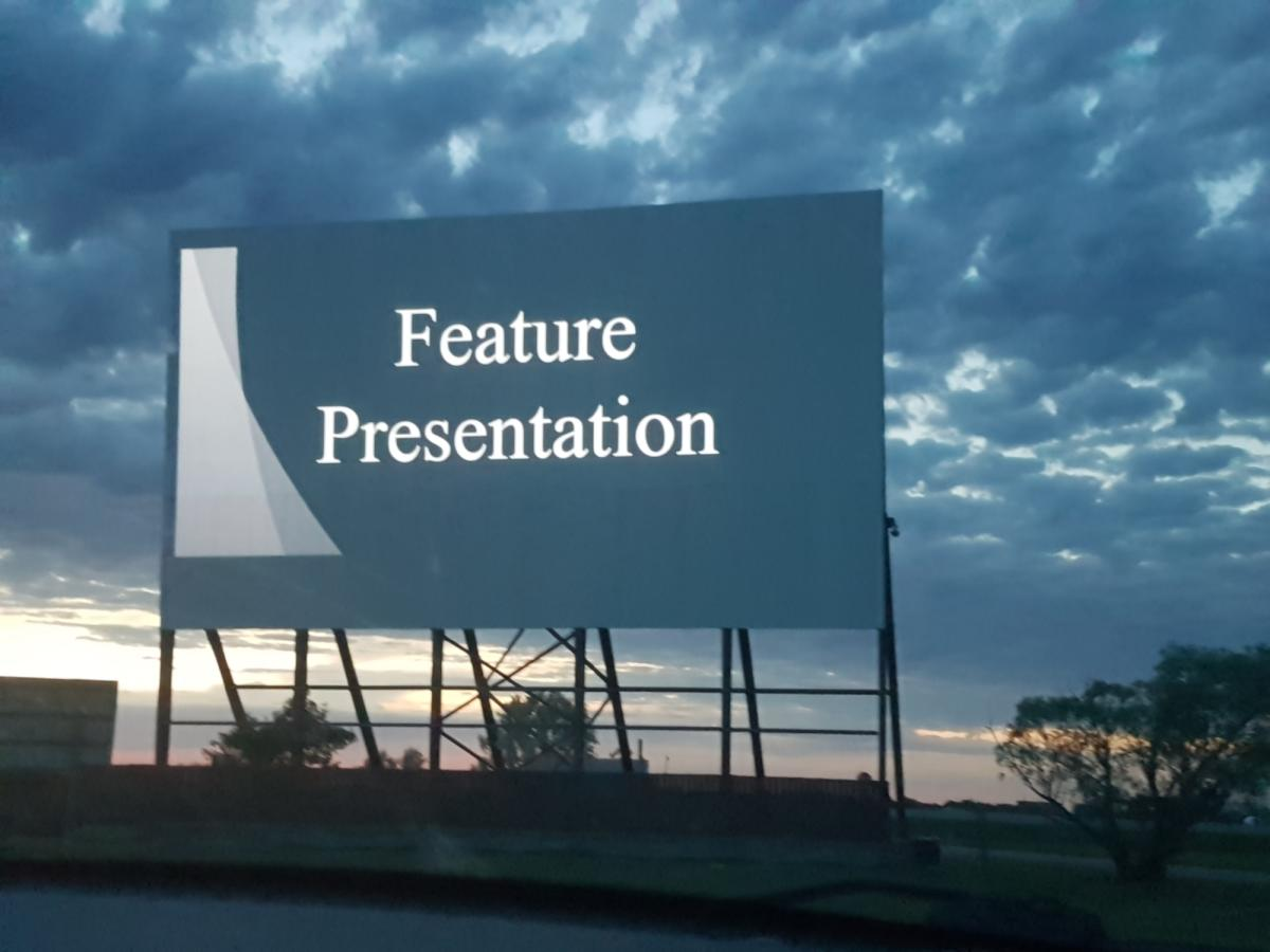 Getting ready for the feature presentation at the Stardust Drive-In Theatre, Morden, Manitoba