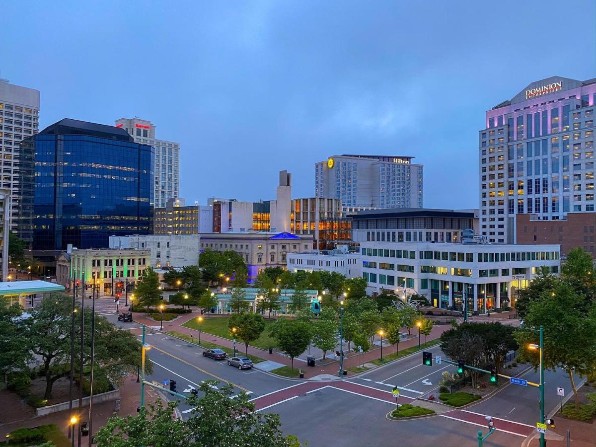 A view of downtown Norfolk at dusk illustrates the town's well-lit sidewalks and public spaces.