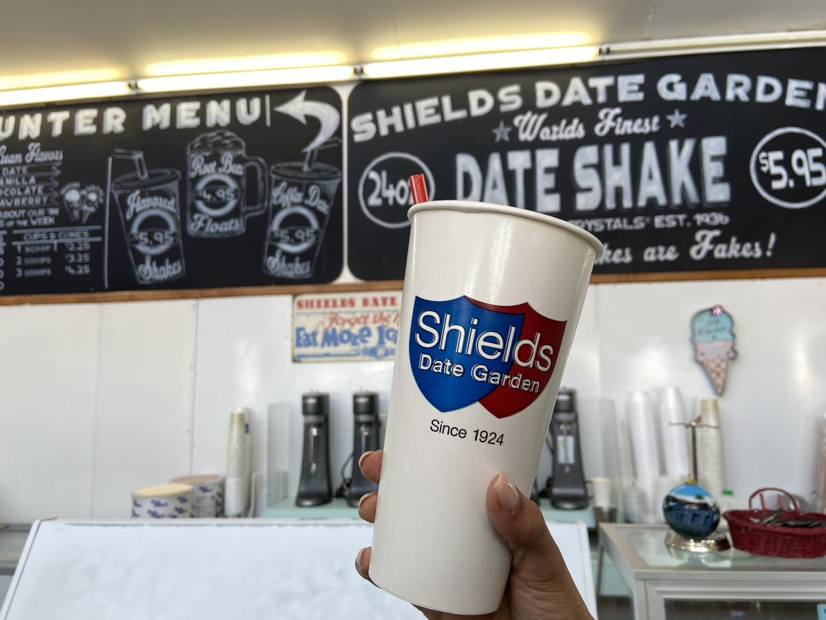 A date shake cup being help up