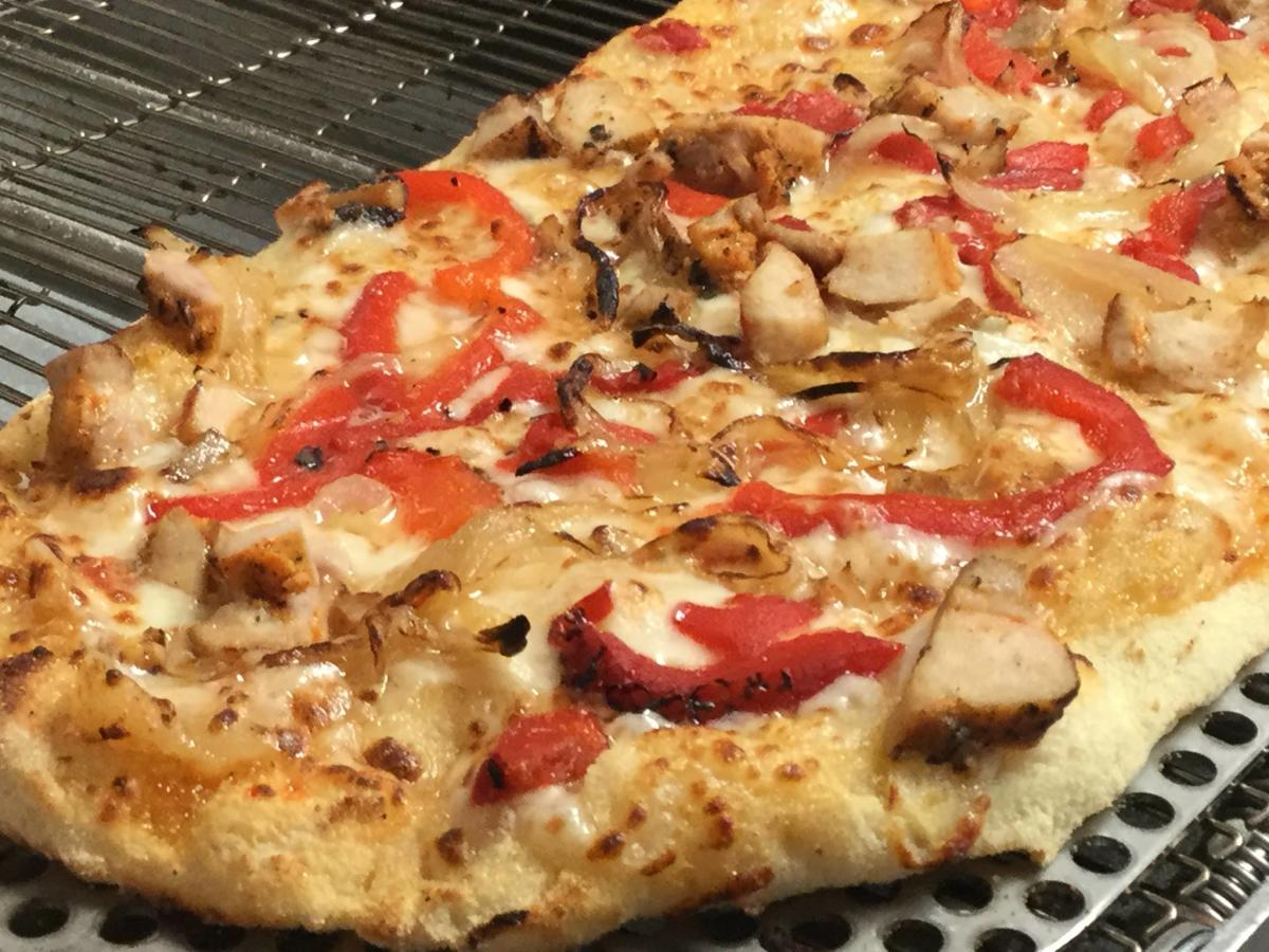 Pizza with toppings from Third Base Pizza Parlor