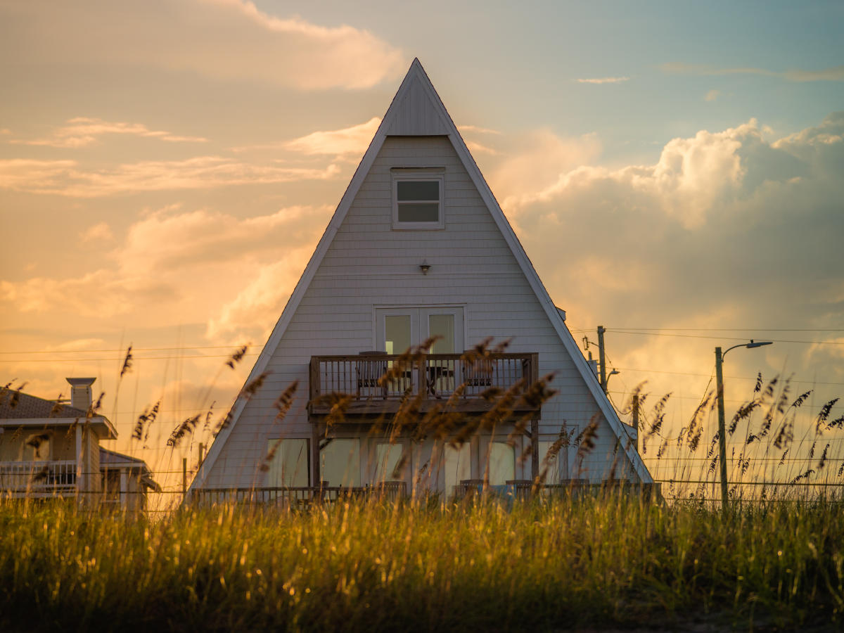 Wrightsville Beach Home with Steep Gable Roof and second-story deck
