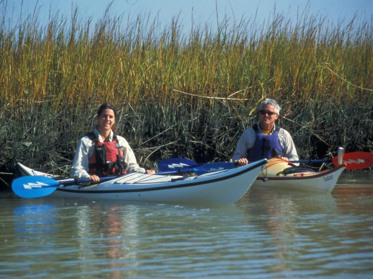 Couple Kayaking near saltmarsh grass