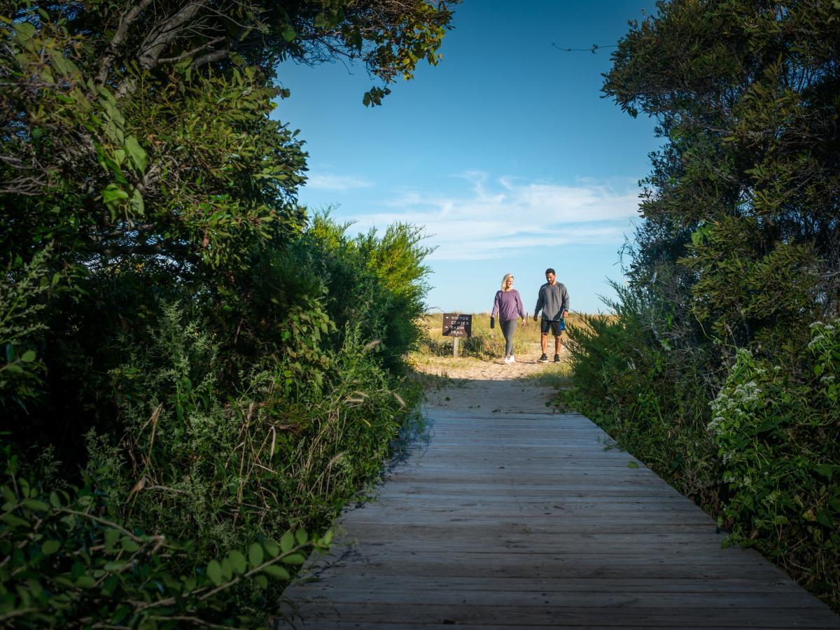 Couple walking along the Basin Trail at the Fort Fisher Recreation Area