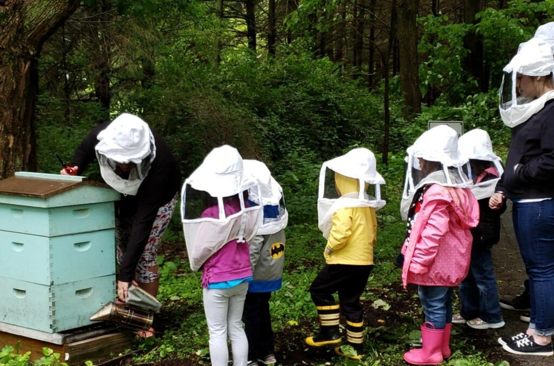 Goddard School Children and a Beehive