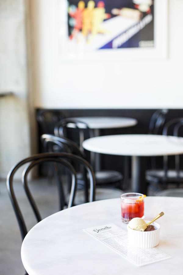 Gelateria Gemelli interior table with gelato bowl and colorful drink