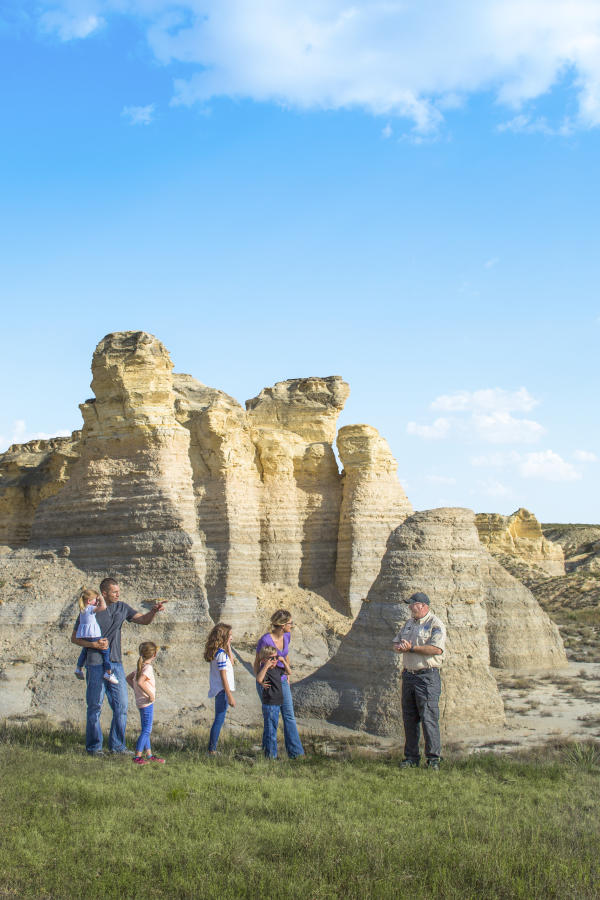 Family talking with Warden at Little Jerusalem Badlands State Park in Logan County, KS