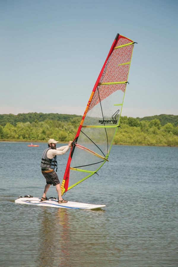 Man windsurfing on Monroe Lake