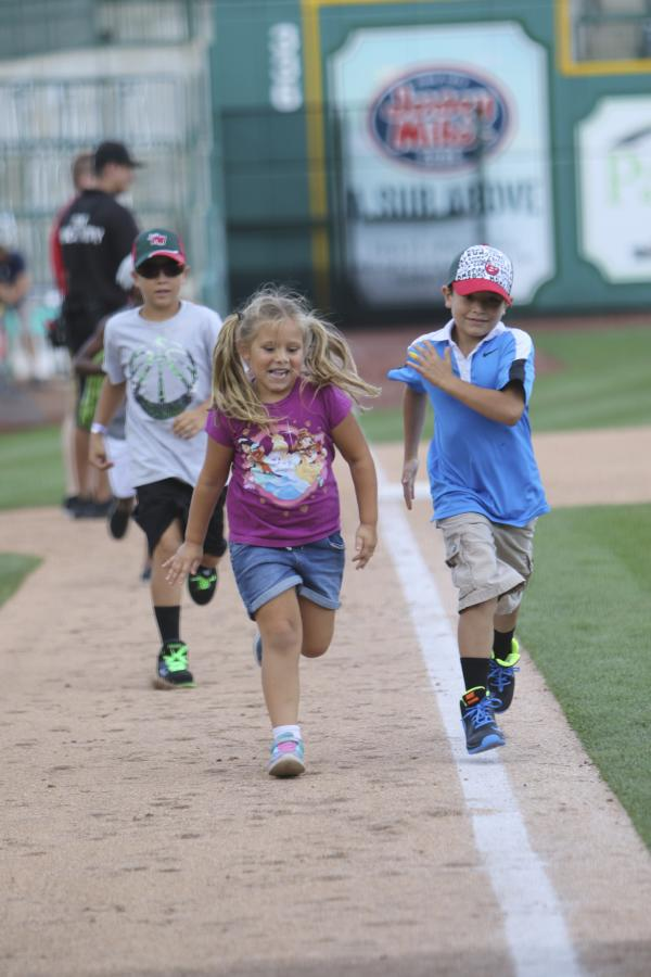 Kids running on Parkview Field's base line