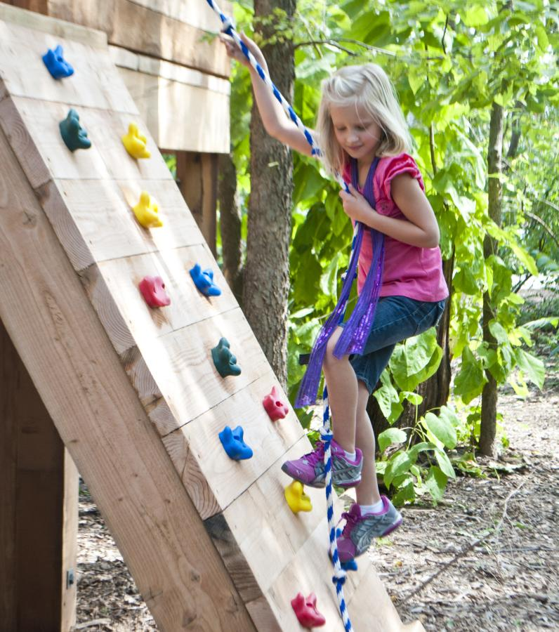 Climbing the outdoor wall at Kansas Children's Discovery Center