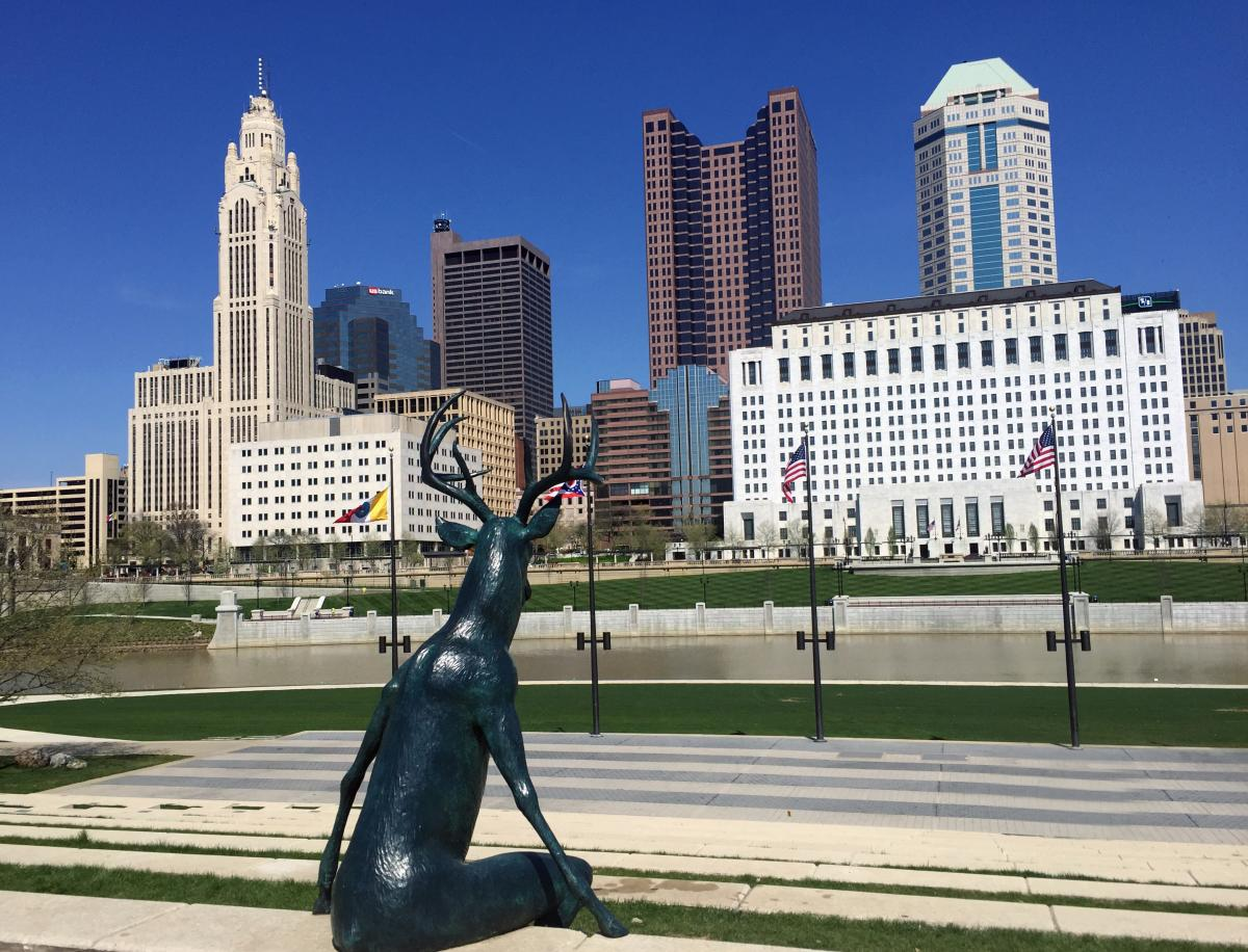 Humanized deer statue viewing the skyline from Genoa Park on the Scioto Mile