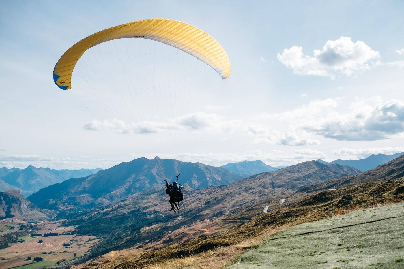 Paragliders over the valley