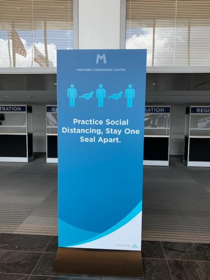 Signs around MCC advise visitors to stay six feet - or one seal - apart for social distancing.