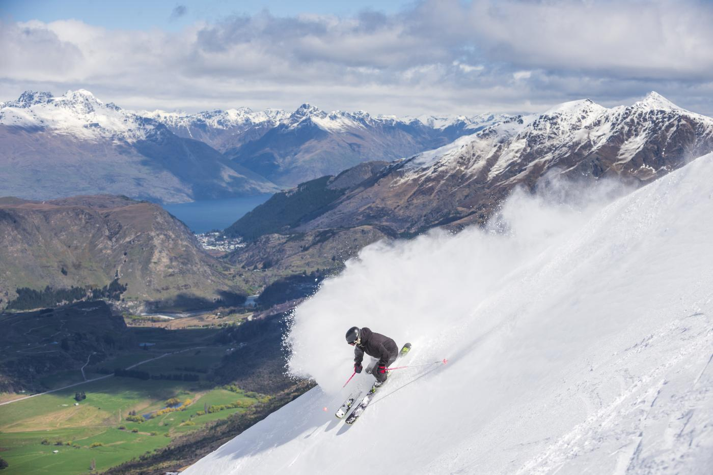 Man Skiing at Coronet Peak with beautiful views over Queenstown