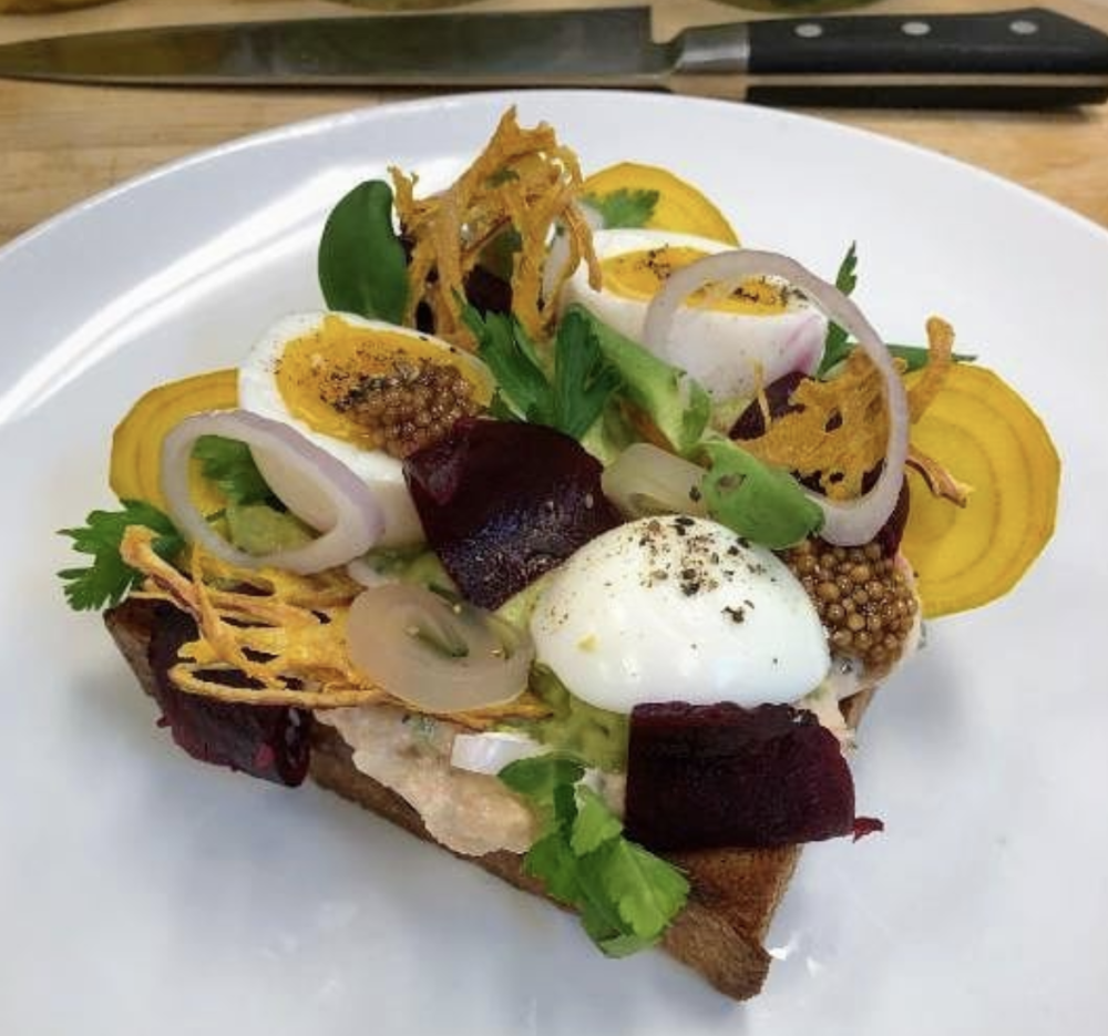 Avocado toast topped with salmon, beets, local eggs, pickled mustard seed, shallot, parsley and crispy onion is on Junk Ditch Brewing Company's seasonal Brunch menu.