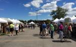 Crowds visit artisans at the Clothesline Festival in Rochester, NY