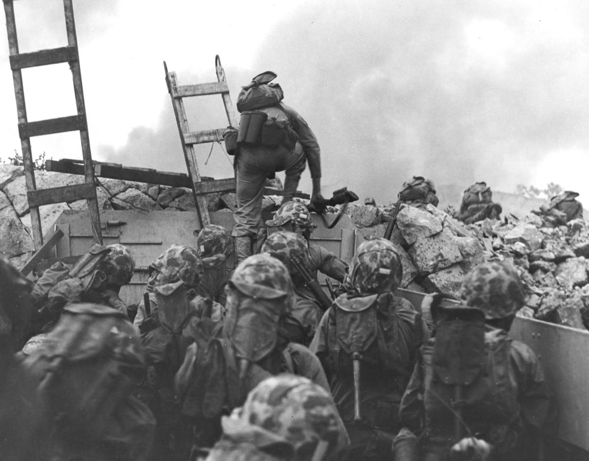 Leathernecks use scaling ladders to storm ashore at Inchon in an amphibious invasion, September 15, 1950
