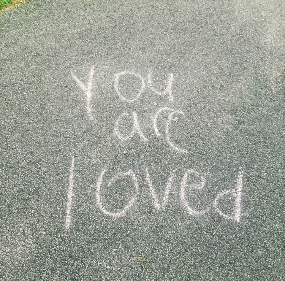 Chalk message at Wade Mountain Greenway in Huntsville