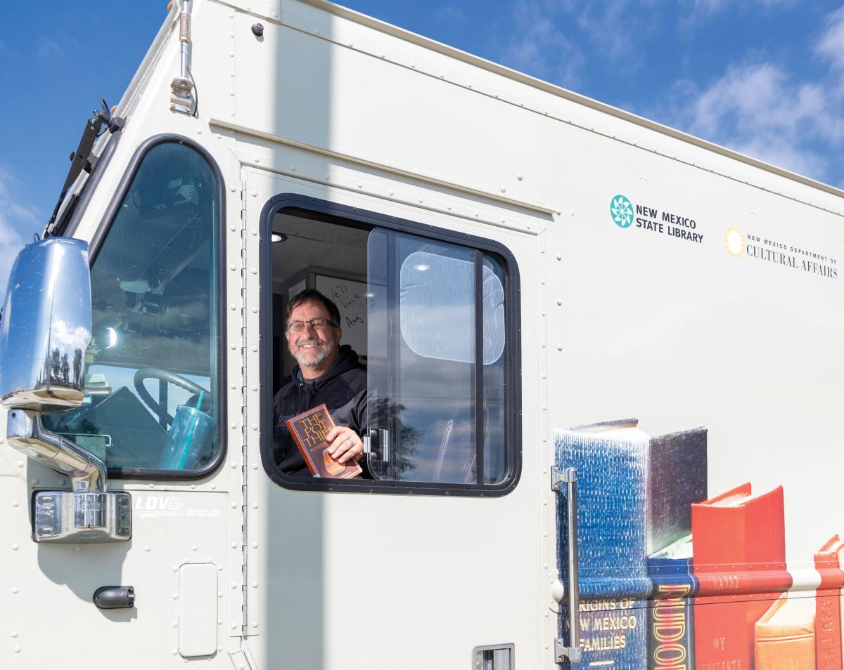 James Gallegos always takes the morning shift at the wheel of the Northeast Bookmobile.