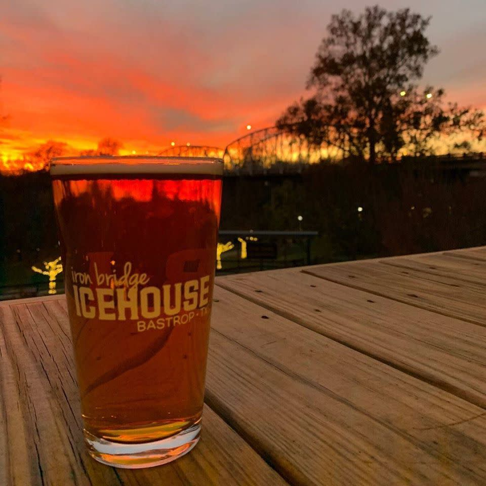 Iron Bridge Icehouse Beer Glass Over Sunset in Bastrop