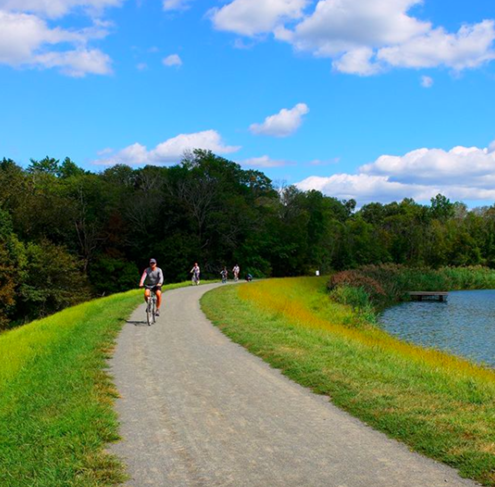 Some bikers riding along the Lawrence Hopewell Trail