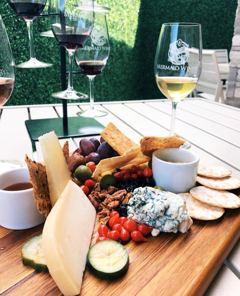 A platter of fresh fruit and cheese is paired with complementary wines at Mermaid Winery.
