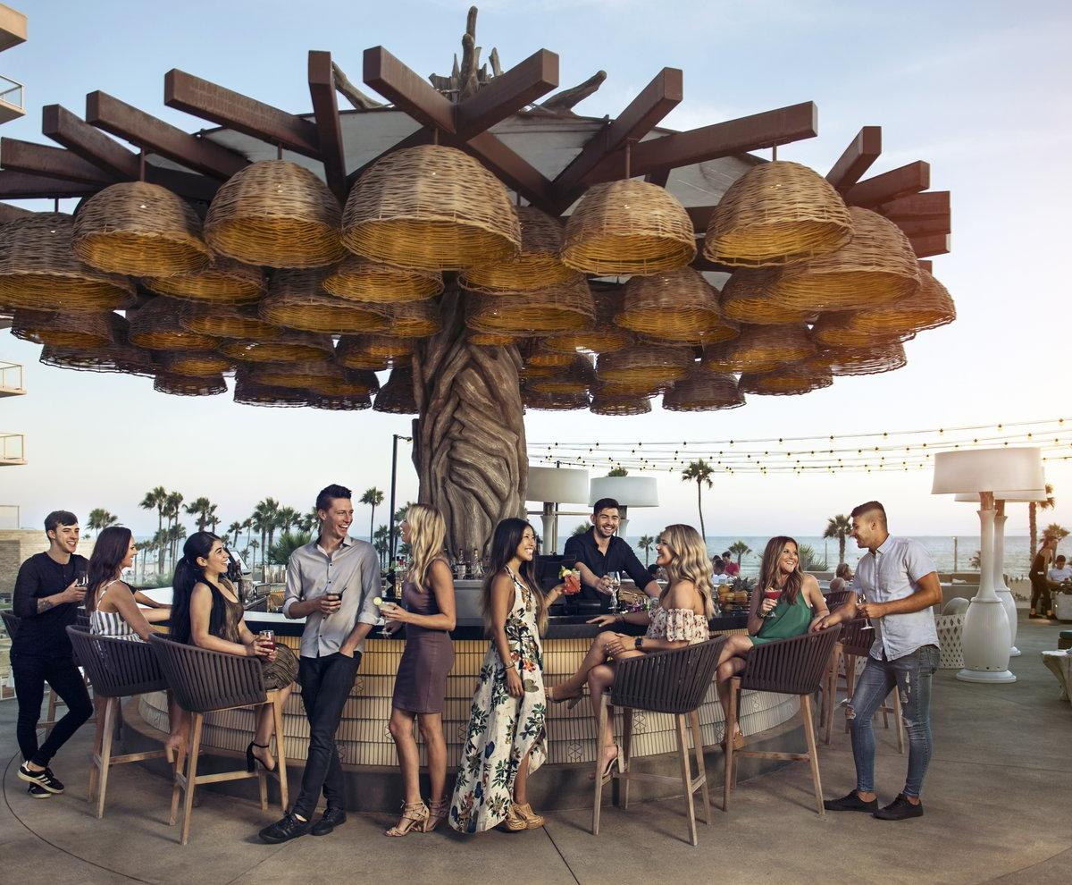 Patrons enjoying drinks at Tanner's Rooftop Bar in Huntington Beach