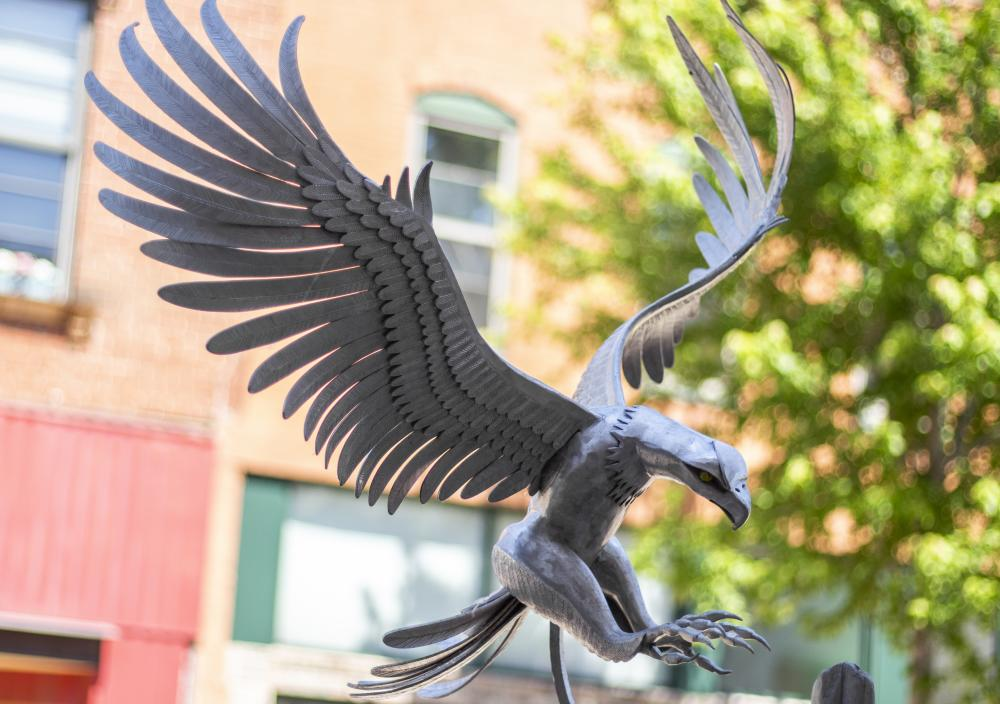 "Often referred to as ""The Eagle Sculpture,"" this work was created by Heather Wall and is titled Wild Wings."