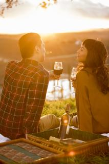 Couple enjoying wine at sunset