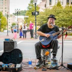 Busker in Pack Square - Square