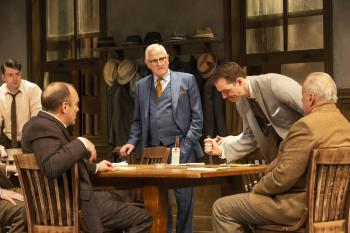 Men at a table from the Syracuse Stage production of 12 Angry Men