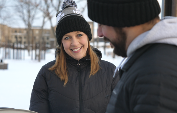 Couple Smiling at River Prairie Winter