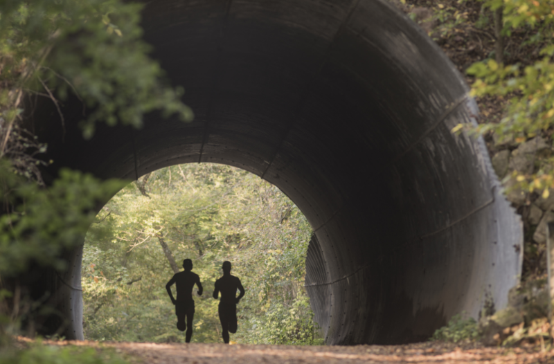 Two people running on the Putnam trail