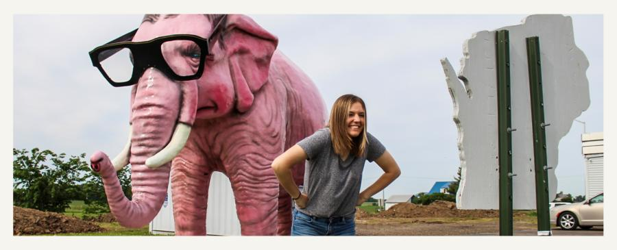 Woman posing in front of Pinkie the Elephant in DeForest, Wisconsin