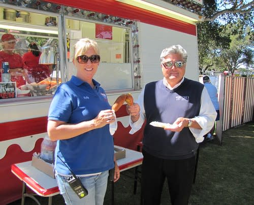 Kelly Violini and David Marzetti enjoy the first official corn dogs at the Monterey County Fair