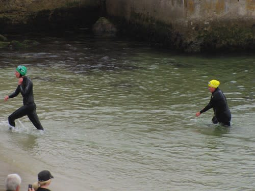 Swimmers exit the water