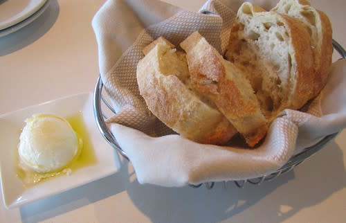 Rosemary bread served with goat cheese and butter spread at The C restaurant + bar