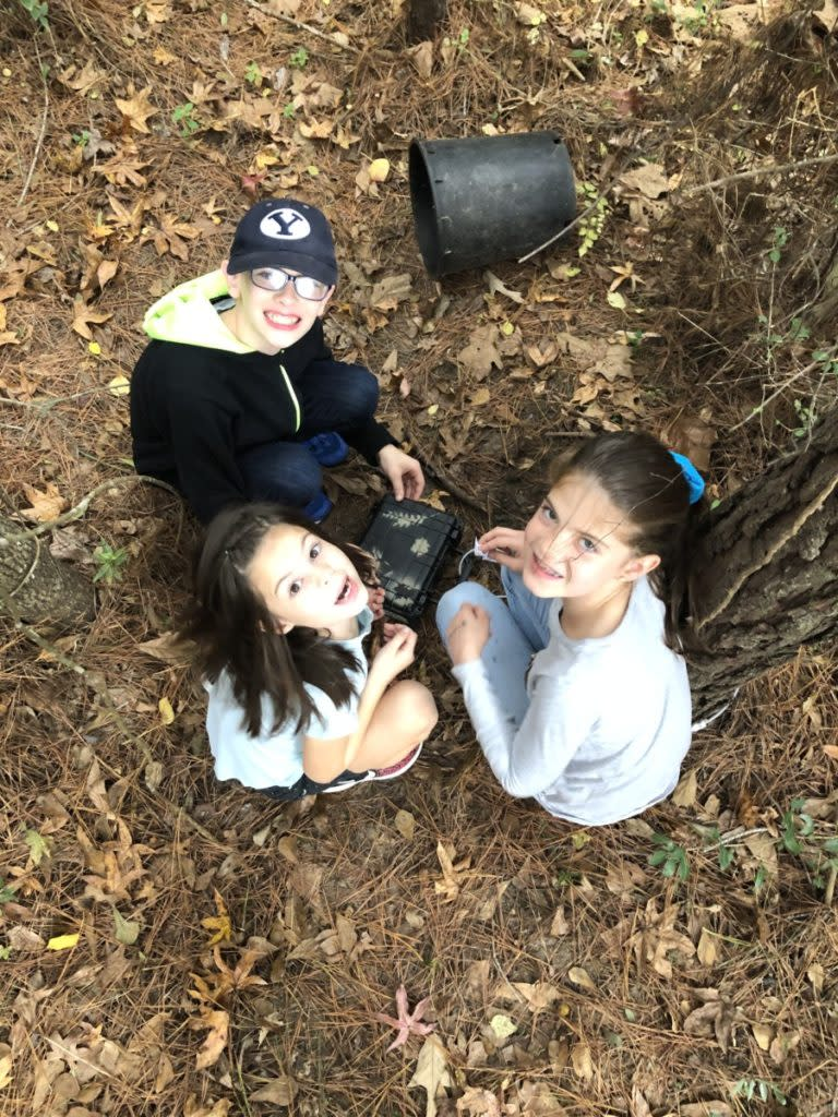 3 kids in the woods finding a Geocache on the Geo Tour in Conroe Texas