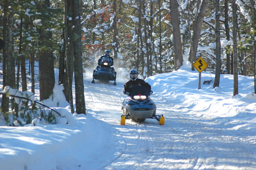 Snowmobiling the Boardman Valley Trail near Muncie Lakes