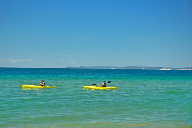 Paddling on Lake Michigan (That's South Manitou Island in the background.)