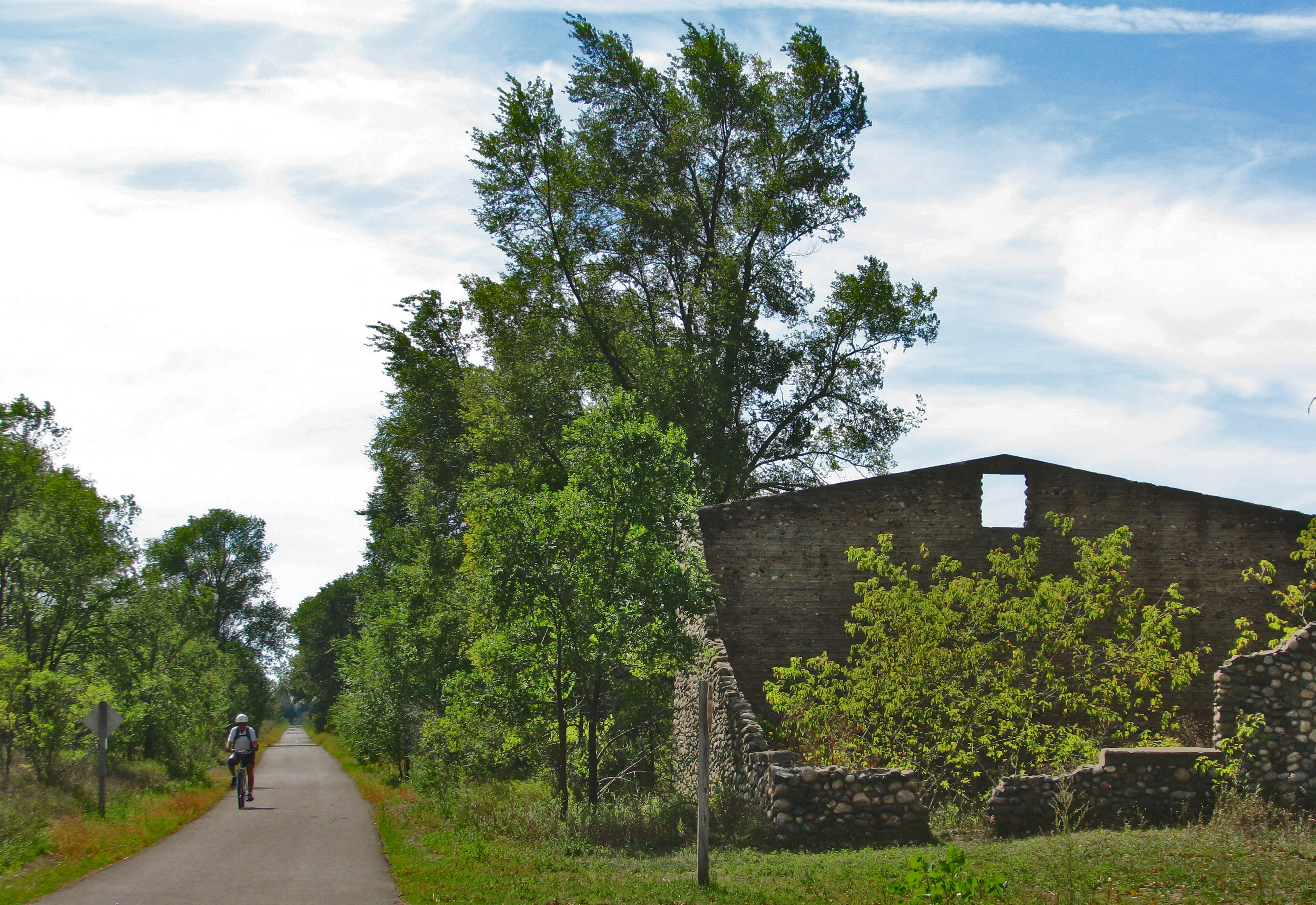 Passing a ruined stone barn on the Leelanau Trail.