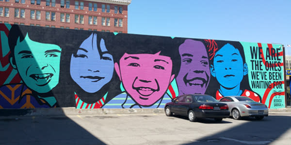 Kids faces mural on Telegraph and 20th in Oakland CA