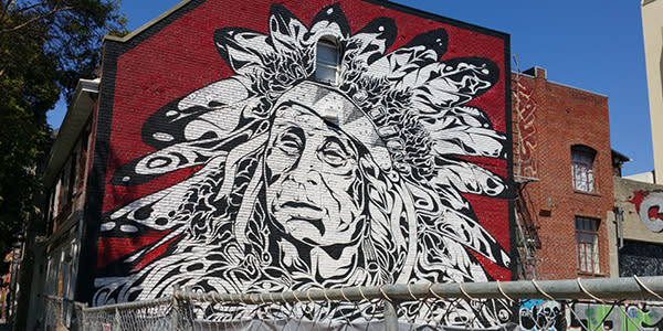 Native American chief street mural in Oakland CA at 15th and Webster