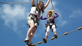 Parents can help kids or adults can help adults as you pass across ropes and through fun balancing feats. Totally exciting - totally safe. check it out!
