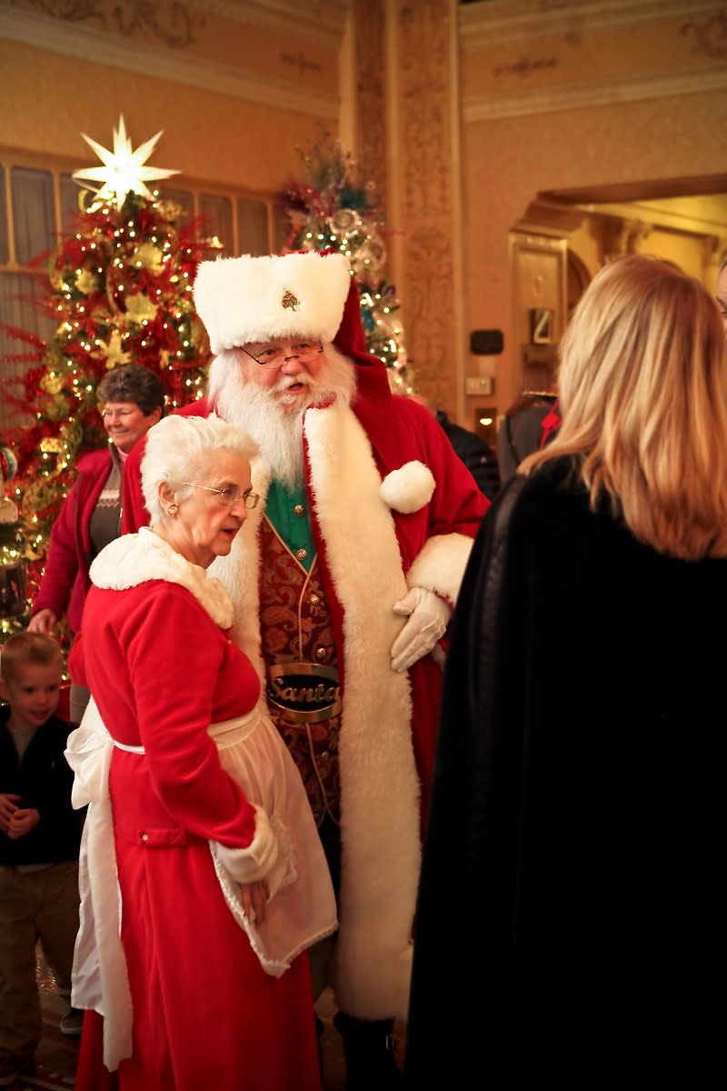 Mr. and Mrs. Claus greet visitors to the Festival of Trees