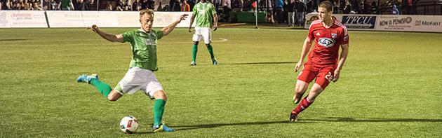Energy FC player preparing to kick the ball