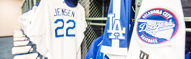 Image of the Oklahoma City Dodgers Locker Room with jerseys hanging up.