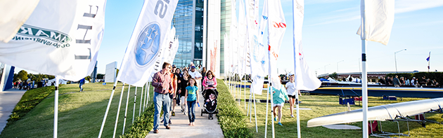 Image of family walking out of Championship Tower at the Oklahoma City Boathouse District during it