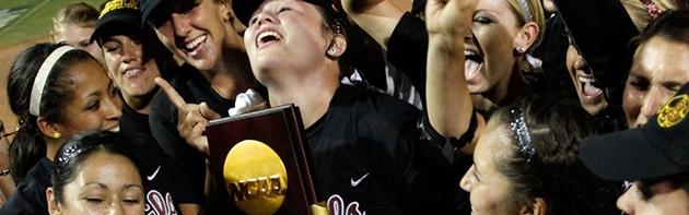 Image of softball players celebrating after winning.