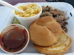 Pulled Pork Barbecue sandwich with a side of macaroni and cheese